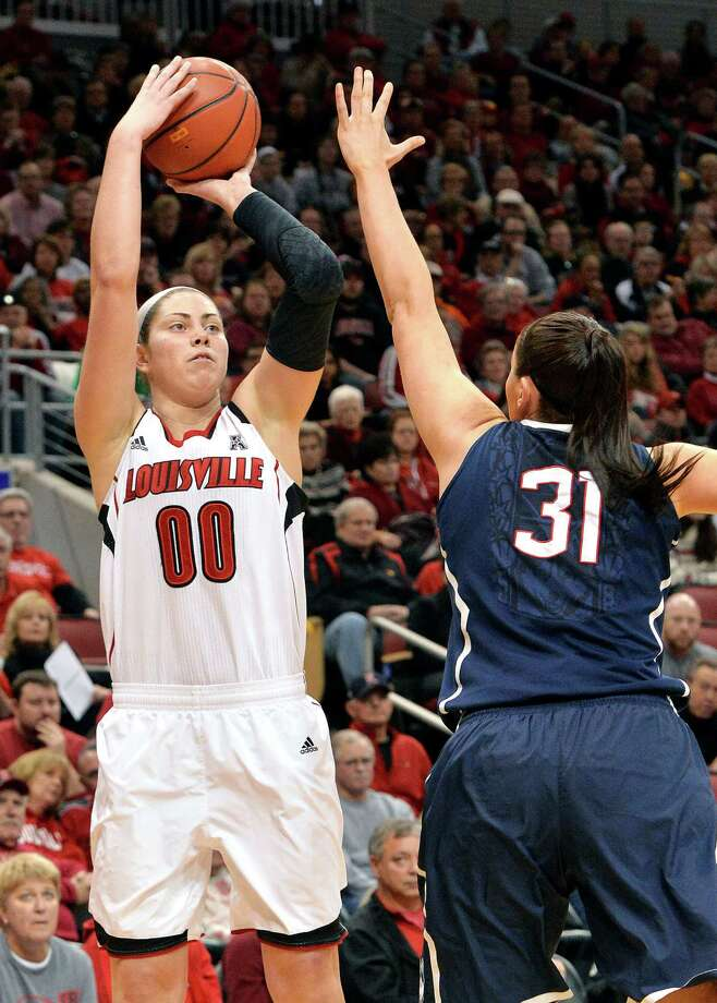 Louisville's Sara Hammond, left, puts up a shot over the defense of Connecticut's Stefanie Dolson during the first half of an NCAA college basketball game, Monday, March 3, 2014, in Louisville, Ky. Photo: Timothy D. Easley, AP / Associated Press