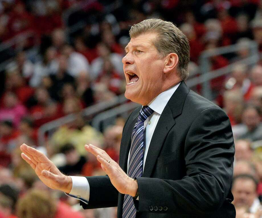 Connecticut head coach Geno Auriemma shouts instructions to his team during the first half of an NCAA college basketball game against Louisville, Monday, March 3, 2014, in Louisville, Ky. Photo: Timothy D. Easley, AP / Associated Press
