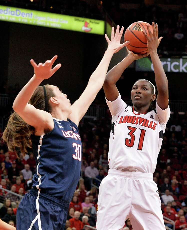 Louisville's Asia Taylor, right, puts up a shot over the defense of Connecticut's Breanna Stewart during the first half of an NCAA college basketball game, Monday, March 3, 2014, in Louisville, Ky. Photo: Timothy D. Easley, AP / Associated Press