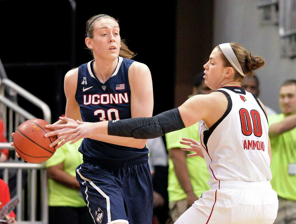 Connecticut's Breanna Stewart, left, looks for help from the defensive pressure of Louisville's Sara Hammond during the first half of an NCAA college basketball game, Monday, March 3, 2014, in Louisville, Ky.
