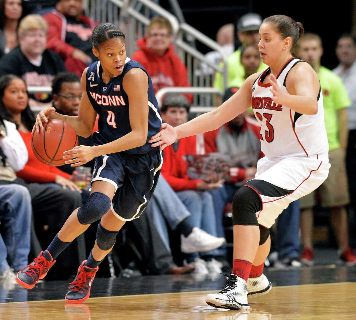 Connecticut Moriah Jefferson, left, attempts to drive around the defense of Louisville's Shoni Schimmel during the first half of an NCAA college basketball game, Monday, March 3, 2014, in Louisville, Ky.