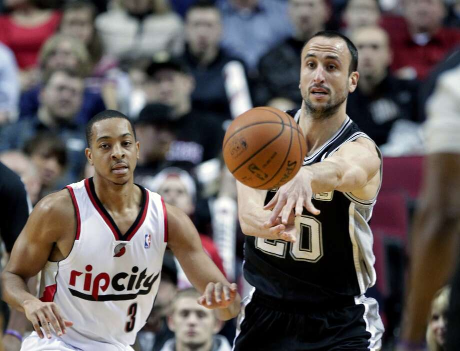 Feb. 19, 2014: Spurs 111, Trail Blazers 109 San Antonio Spurs guard Manu Ginobli, from Argentina, right, passes off as Portland Trail Blazers guard CJ McCollum defends during the first half of an NBA basketball game in Portland, Ore. Photo: Don Ryan, Associated Press