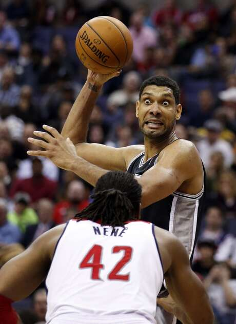 Feb. 5, 2014: Spurs 125, Wizards 118 (2OT)San Antonio Spurs forward Tim Duncan, top, looks to pass over Washington Wizards forward Nene (42), from Brazil, in the second half of an NBA basketball game on Wednesday, Feb. 5, 2014, in Washington. Duncan had 31 points. Photo: Alex Brandon, Associated Press
