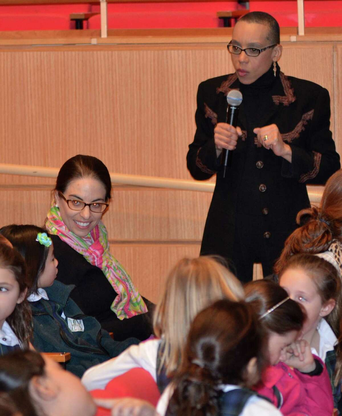Author Andrea Davis Pinkney talks with students during a presentation Monday, March 3 at Greenwich Academy.