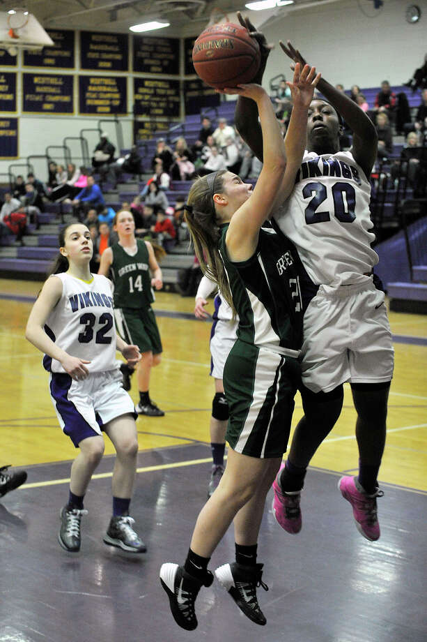 Westhill's Tyler Evans blocks the shot of Corinne Heymach, of New Milford, during their Class LL basketball game at Westhill High School in Stamford, Conn., on Monday, March 3, 2014. Westhill won, 40-30. Photo: Jason Rearick / Stamford Advocate