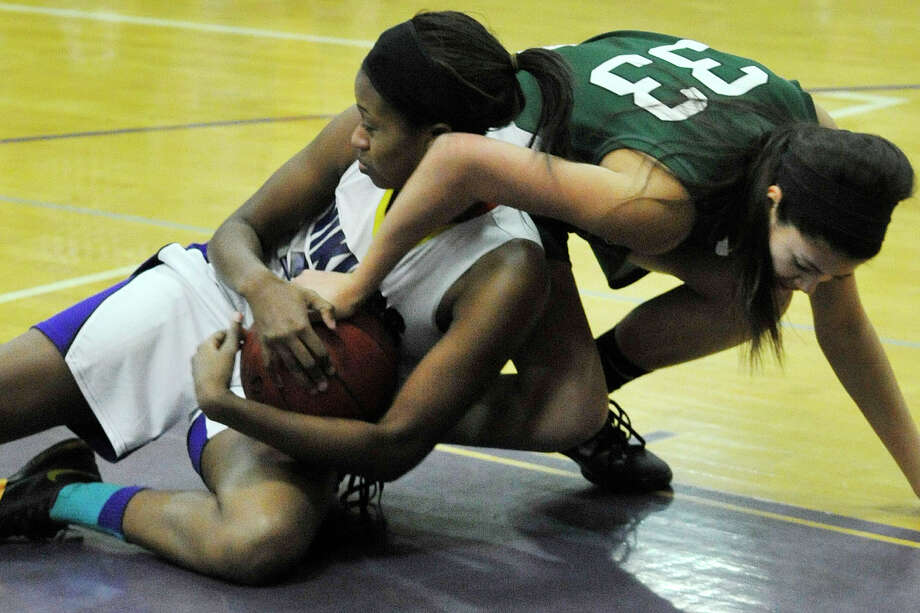 Westhill's Krystal Dixon and New Milford's Emily Llerena battle over a loose ball during their Class LL basketball game at Westhill High School in Stamford, Conn., on Monday, March 3, 2014. Westhill won, 40-30. Photo: Jason Rearick / Stamford Advocate