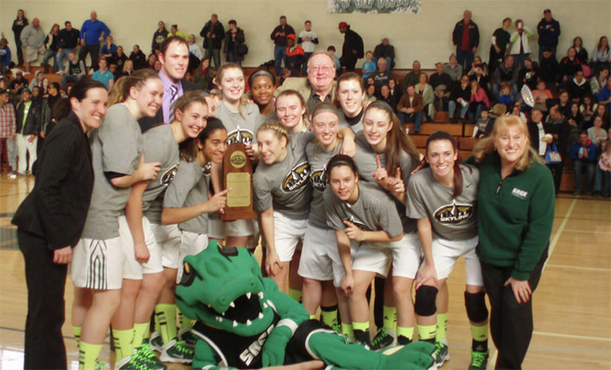 Russell Sage's women's basketball team celebrates its 61-55 victory over Mount St. Vincent that earned the Gators a berth in the Division III NCAA Tournament. (Russell Sage sports information)