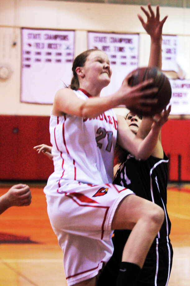 Greenwich's Abigail Wolf shoots as Greenwich High School hosts Bristol Central in a first round Class LL state tournament girls basketball game in Greenwich, Conn., Mar. 3, 2014. Photo: Keelin Daly / Stamford Advocate Freelance
