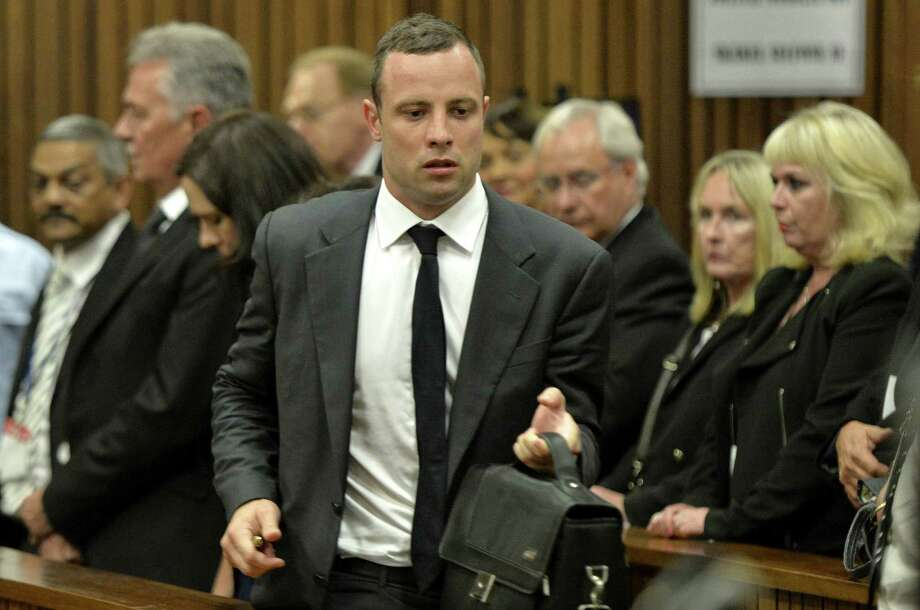 Oscar Pistorius appears in court to answer charges he willfully shot his girlfriend Reeva Steenkamp dead on Valentine's Day 2013. Photo: Themba Hadebe / AFP / Getty Images / AFP
