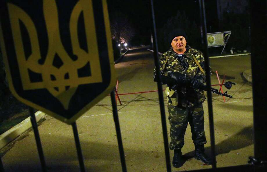 A Ukrainian soldier at the Belbek military base in Lubimovka, where between 100 and 200 soldiers are stationed, stands on alert anticipating a possible Russian attack. Photo: Sean Gallup / Getty Images / 2014 Getty Images
