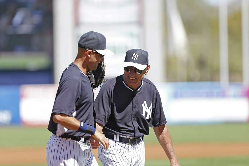 TAMPA, FL - MARCH 3:  Derek Jeter #2 (L) of the New York Yankees and former New York Jets quarterbac
