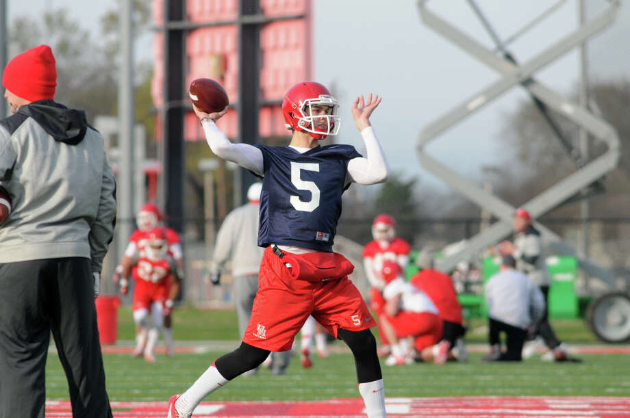 UH quarterback John O'Korn makes a throw during the during the Cougars' first spring football practice. Photo: Jerry Baker, For The Chronicle