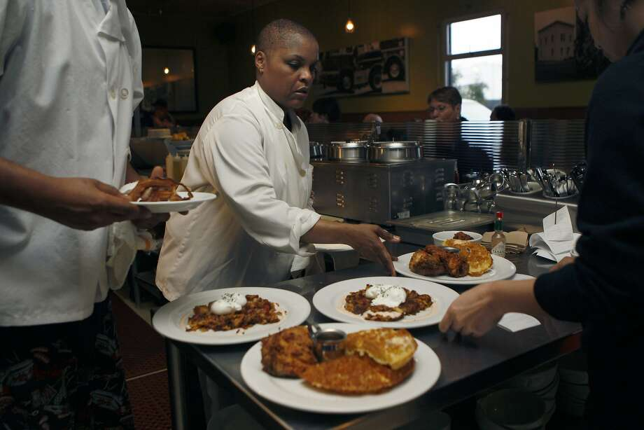 Tanya Holland plates breakfasts at Brown Sugar Kitchen in West Oakland. She later opened B-Side BBQ not far away and dreams of starting other restaurants. Photo: Liz Hafalia, The Chronicle