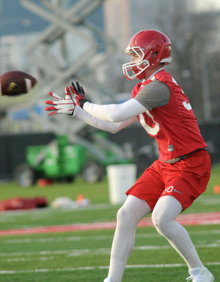 UH junior wide receiver Grayson Hughes makes a catch during an offensive drill during the Cougars' first spring football practice. Photo: Jerry Baker, For The Chronicle