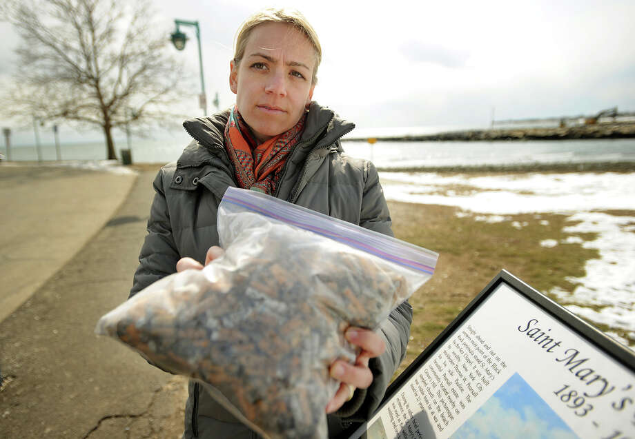 Anna Price shows a bag of cigarette butts that she collected at St. Mary's by the Sea in Bridgeport, Conn. on Thursday, February 27, 2014. Price is pursuing a smoking ban in the parks. Photo: Brian A. Pounds / Connecticut Post
