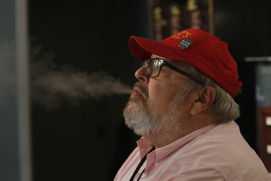 Andy Michelson exhales vapor from an e-cigarette while working at the Vapor Den on Monday, March 3, 2014,  in San Francisco, Calif. Photo: Lea Suzuki, The Chronicle