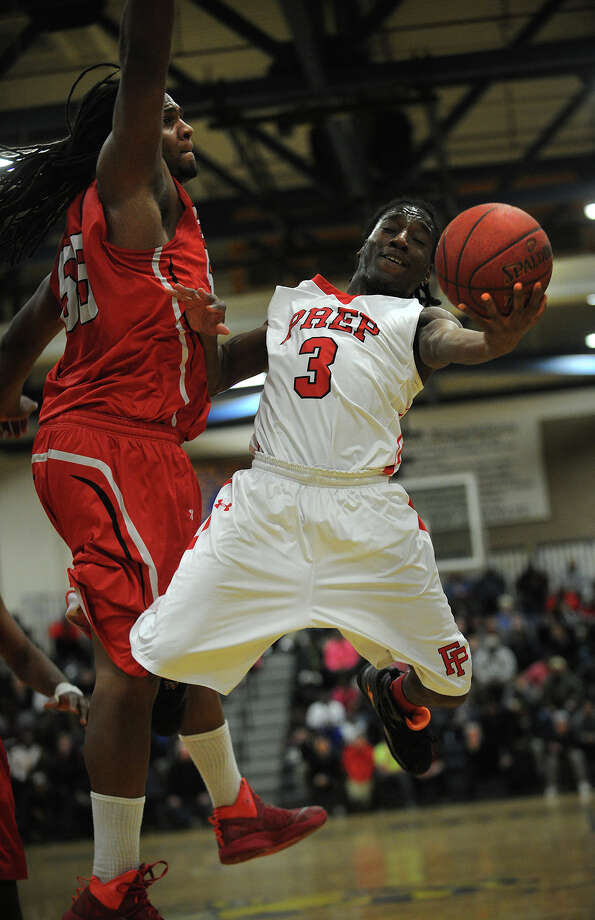 Fairfield Prep's Keith Pettway drives to the basket against Wilbur Cross defender Jaelin Robinson in the first half of their SCC boys basketball semifinal game at East Haven High School in East Haven, Conn. on Monday, March 3, 2014. Photo: Brian A. Pounds / Connecticut Post