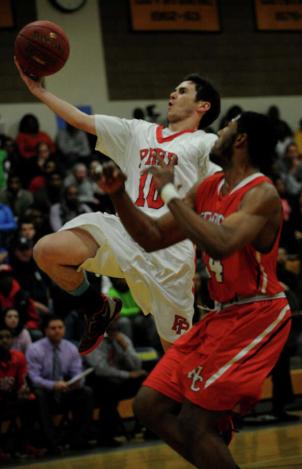 Fairfield Prep's Ray Featherston drives to the basket against Wilbur Cross defender Robert Durant, Jr. in the first half of their SCC boys basketball semifinal game at East Haven High School in East Haven, Conn. on Monday, March 3, 2014. Photo: Brian A. Pounds / Connecticut Post