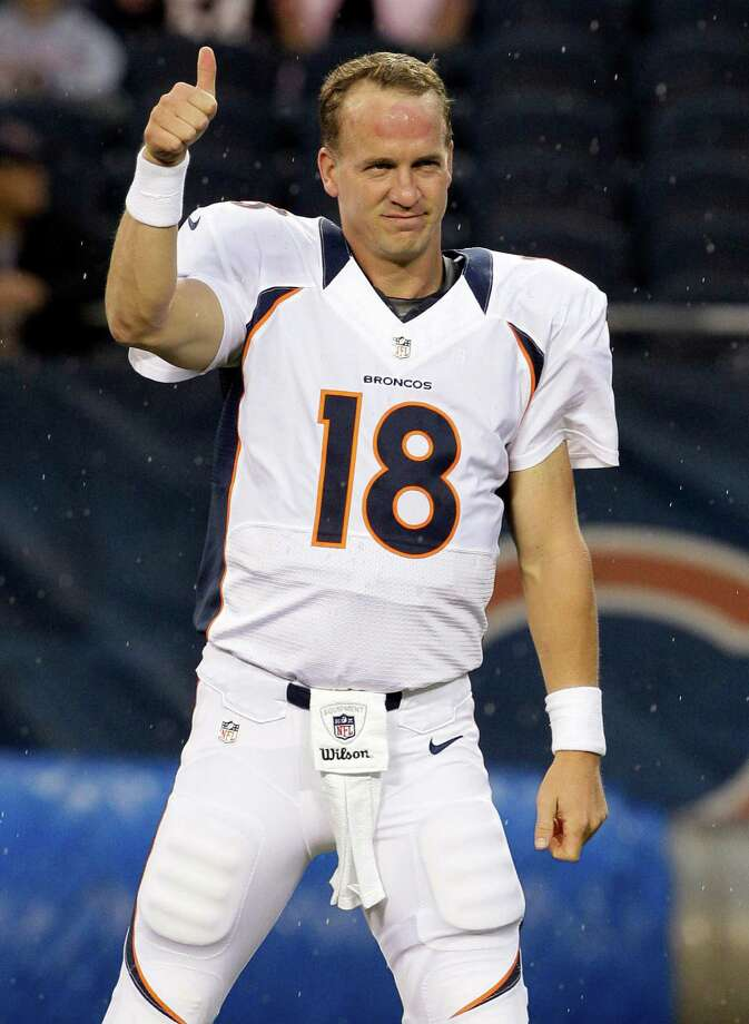 FILE - In  this Aug. 9, 2012 file photo, Denver Broncos quarterback Peyton Manning gestures before an NFL preseason football game against the Chicago Bears, in Chicago. A person with knowledge of the results tells The Associated Press that Manning has passed his physical on his surgically repaired neck, clearing the way for him to play in 2014. In what was considered the final formality for his return, Manning passed the exam as required by his contract that will pay him $20 million next season, according to the person who spoke on condition of anonymity because  (AP Photo/Nam Y. Huh, File) ORG XMIT: NY163 Photo: Nam Y. Huh / AP