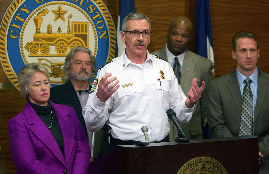Houston Fire Chief Terry Garrison, center, Mayor Annise Parker and fire union president Bryan Sky-Eagle, right,  give news media the details of a tentative deal to avoid a budget crisis during a City Hall news conference on Monday. Photo: Cody Duty, Staff / © 2014 Houston Chronicle