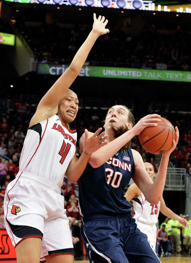 Connecticut's Breanna Stewart, right, looks to the basket around the defense of Louisville's Antonita Slaughter during the second half of an NCAA college basketball game, Monday, March 3, 2014, in Louisville, Ky. Connecticut won 68-48. Photo: Timothy D. Easley, AP / Associated Press