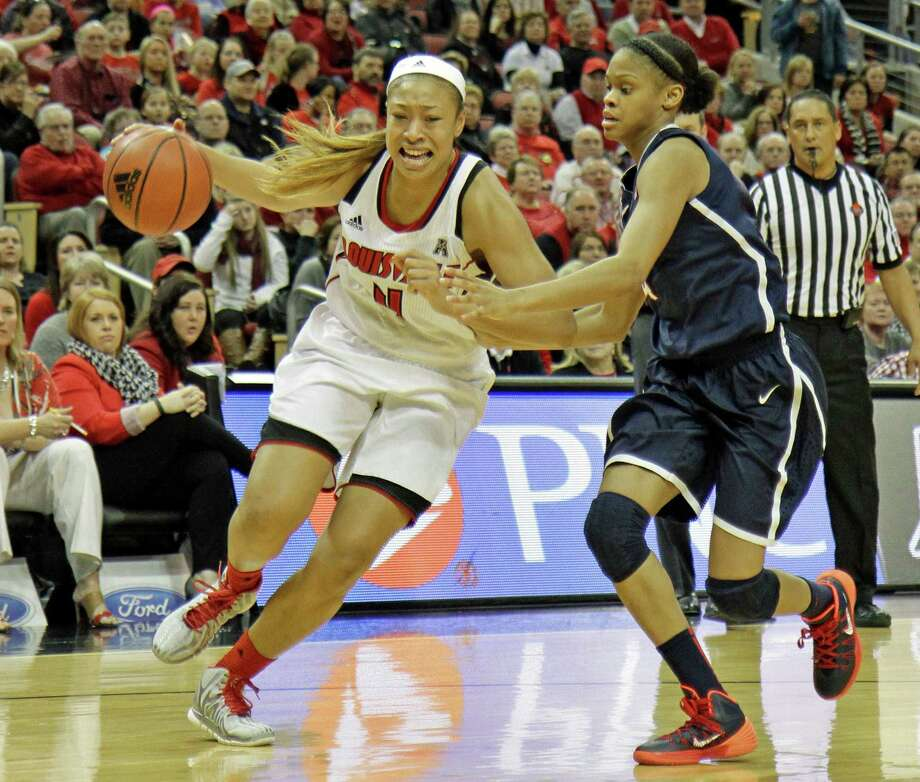 Louisville senior Antonita Slaughter, left, drives past Connecticut defender Moriah Jefferson, right, in their NCAA women's college basketball game in Louisville. Ky., Monday, Mar. 3, 2014. Photo: Garry Jones, AP / Associated Press