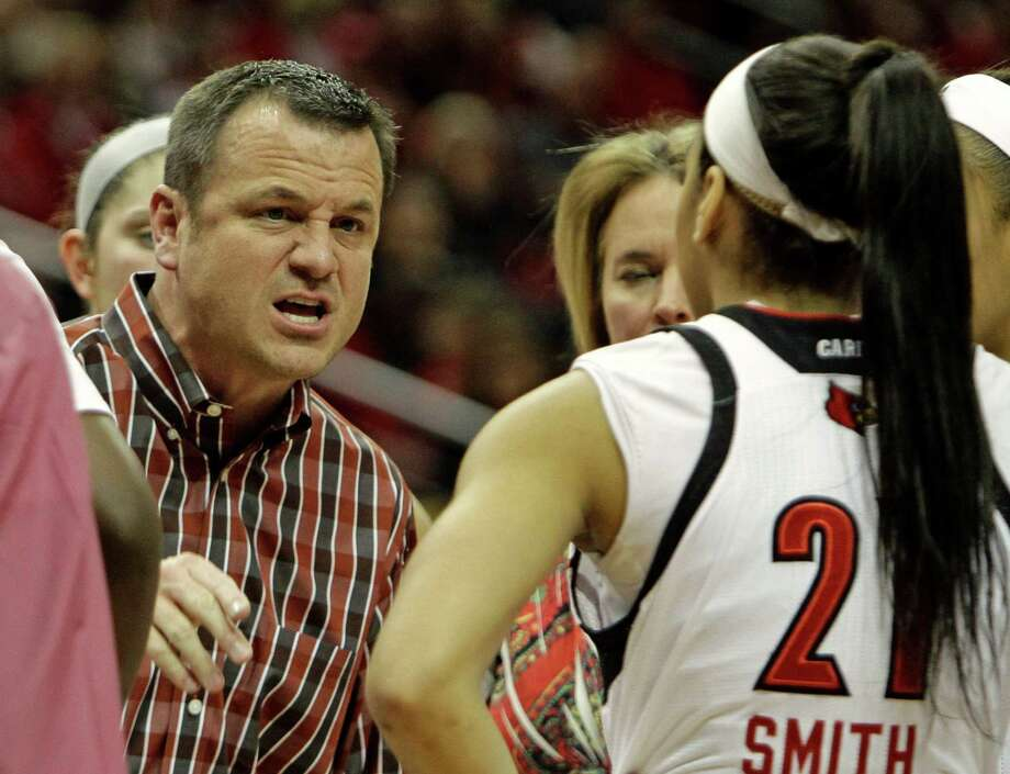Louisville coach Jeff Walz gestures as he talks to his team, including guard Bria Smith (21) during a timeout in their NCAA women's college basketball game against top-ranked Connecticut in Louisville. Ky., Monday, Mar. 3, 2014. Photo: Garry Jones, AP / Associated Press