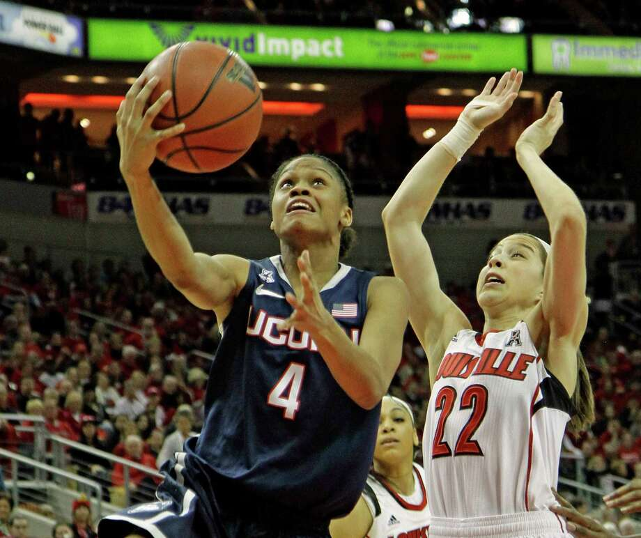 Connecticut's Moriah Jefferson (4) attempts a shot inside against Louisville's Jude Schimmel (22) in their NCAA women's college basketball game in Louisville. Ky., Monday, Mar. 3, 2014. Photo: Garry Jones, AP / Associated Press