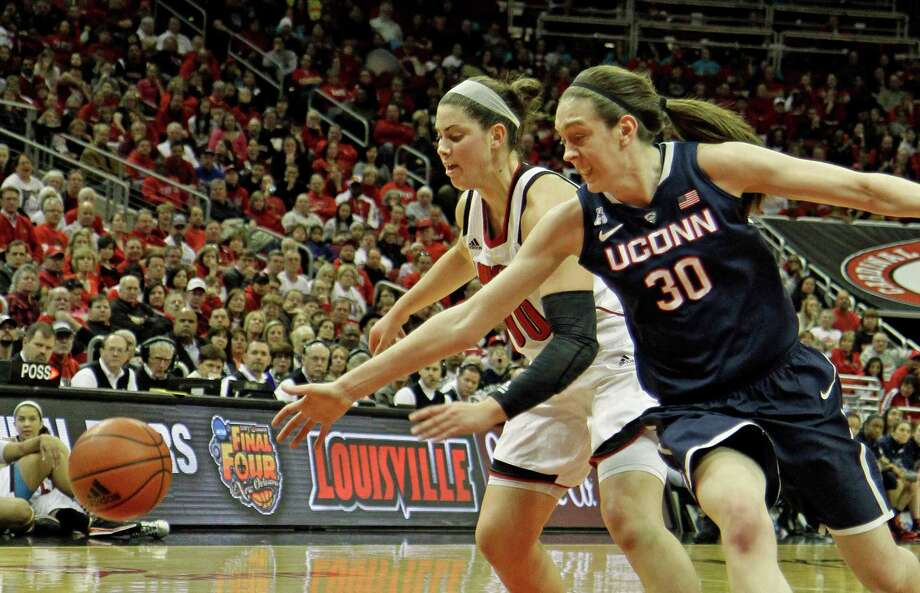Louisville's Sara Hammond, left, and Connecticut's Breanna Stewart (30) go after a loose ball in their NCAA women's college basketball game in Louisville. Ky., Monday, Mar. 3, 2014. Photo: Garry Jones, AP / Associated Press