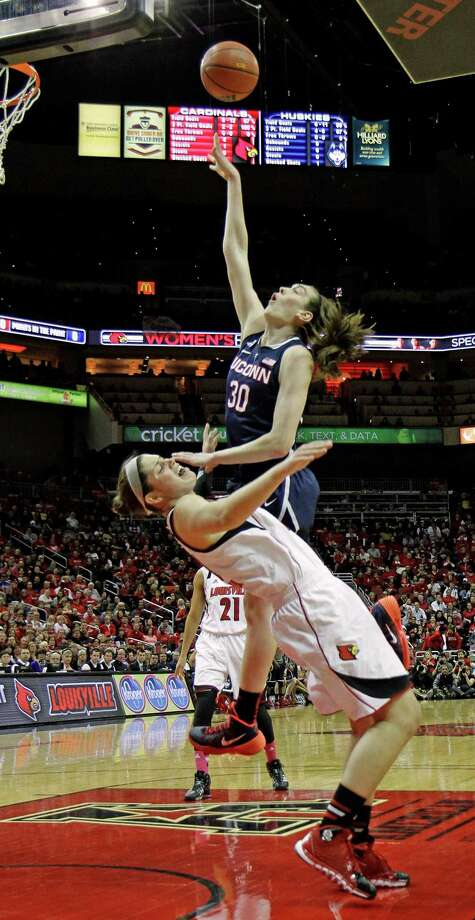 Connecticut forward Breanna Stewart (30) goes over Louisville defender Sara Hammond to score inside in their NCAA women's college basketball game in Louisville. Ky., Monday, Mar. 3, 2014. Photo: Garry Jones, AP / Associated Press