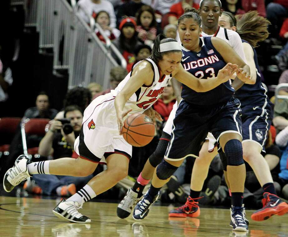 Louisville senior guard Tia Gibbs, left, drives against Connecticut defender Kaleena Mosqueda-Lewis (23) in their NCAA women's college basketball game in Louisville. Ky., Monday, Mar. 3, 2014. Photo: Garry Jones, AP / Associated Press