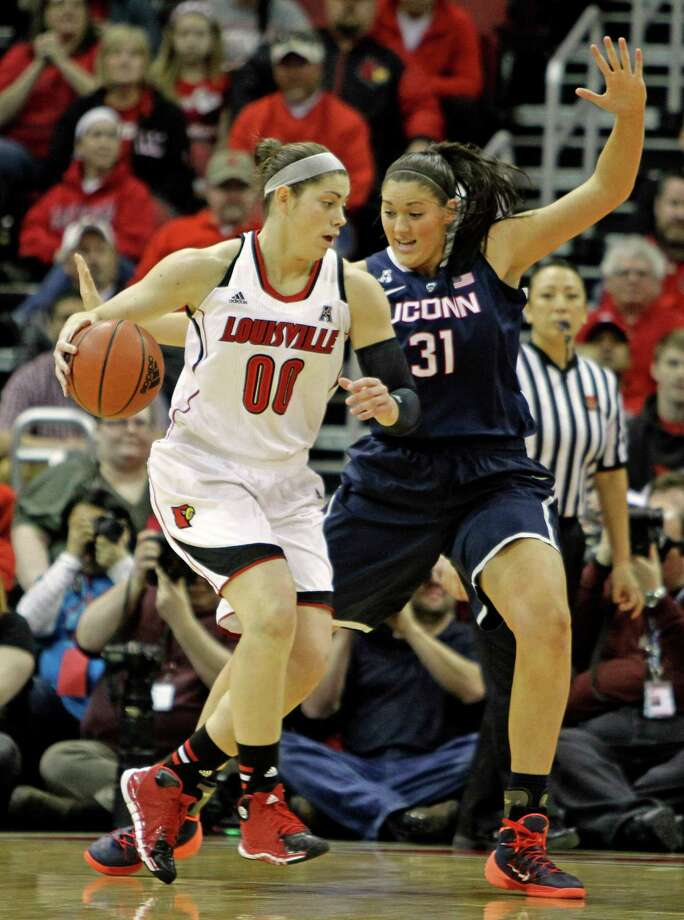 Louisville forward Sara Hammond (00) drives against Connecticut defender Stefanie Dolson (31) in their NCAA women's college basketball game in Louisville. Ky., Monday, Mar. 3, 2014. Photo: Garry Jones, AP / Associated Press