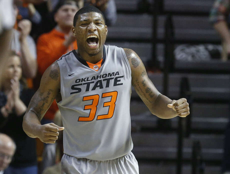 Marcus Smart, whose 20 second-half points sparked an upset of No. 8 Kansas on Saturday, told ESPN that OSU was told Jayhawks coach Bill Self said KU would cut down the nets if it won. Photo: Sue Ogrocki / Associated Press / AP