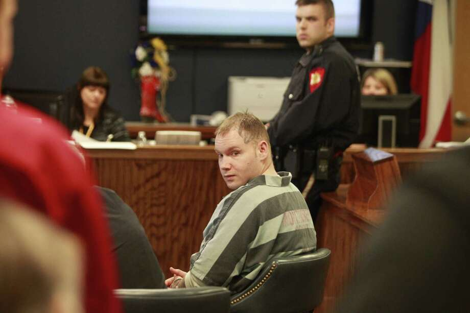 Donald Wilburn Collins, who is accused of assaulting Robbie Middleton and setting him on fire, sits in the 359th State District Court during his hearing in Conroe on Monday. Photo: Melissa Phillip