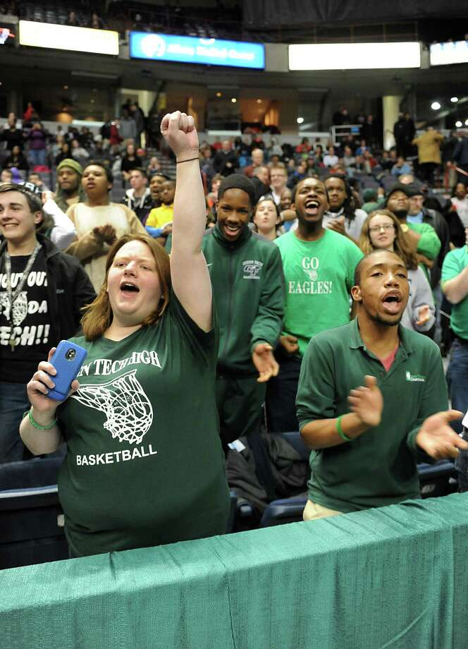 Green Tech fans go wild as their team is winning in the final minute of the Class AA boys' basketball final against Guilderland at the Times Union Center on Monday, March 3, 2014 in Albany, N.Y.  (Lori Van Buren / Times Union) Photo: Lori Van Buren / 00025965A