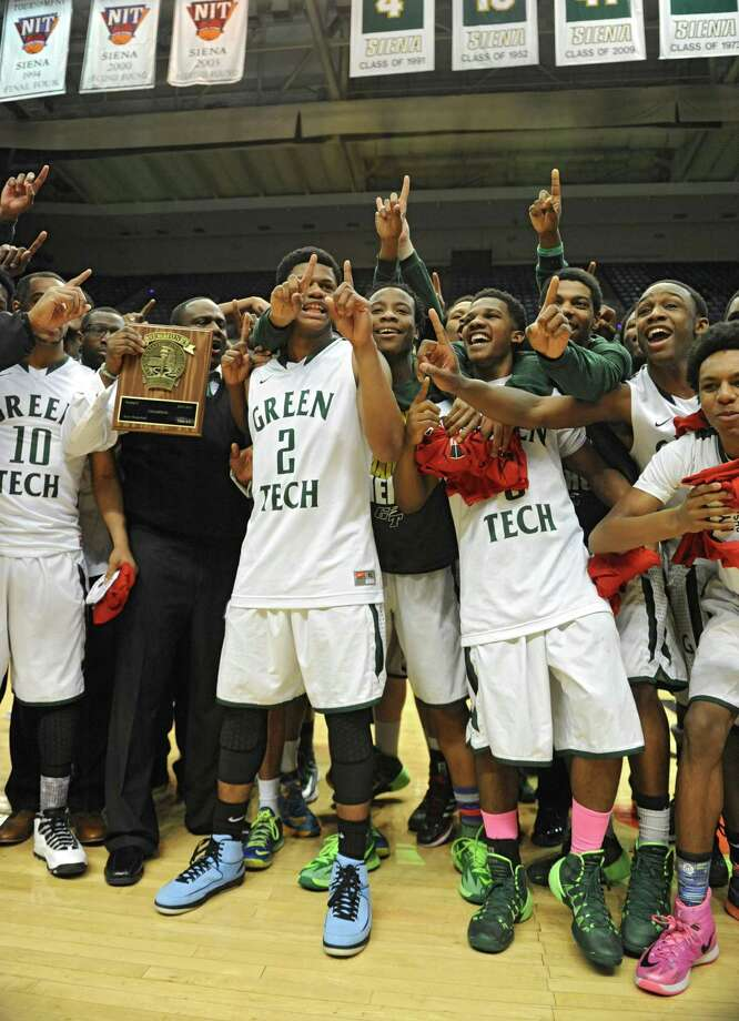 Green Tech's boys celebrate after defeating Guilderland in the Class AA boys' basketball final at the Times Union Center on Monday, March 3, 2014 in Albany, N.Y. (Lori Van Buren / Times Union) Photo: Lori Van Buren / 00025965A