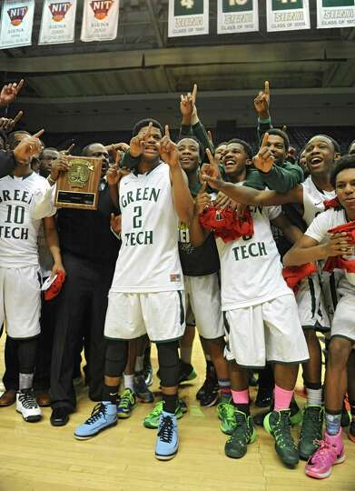 Green Tech's boys celebrate after defeating Guilderland in the Class AA boys' basketball final at th