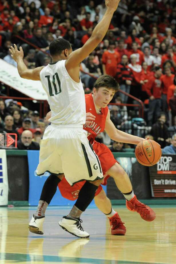 Guilderland's Andrew Platek is guarded by Green Tech's Jizziah Carr during the Class AA boys' basketball final at the Times Union Center on Monday, March 3, 2014 in Albany, N.Y. (Lori Van Buren / Times Union) Photo: Lori Van Buren / 00025965A