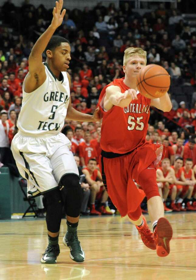 Guilderland's Matt Cerutti is guarded by Green Tech's David Clark during the Class AA boys' basketball final at the Times Union Center on Monday, March 3, 2014 in Albany, N.Y. (Lori Van Buren / Times Union) Photo: Lori Van Buren / 00025965A