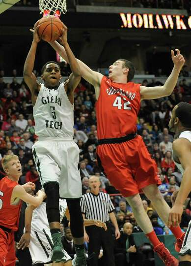 Green Tech's David Clark and Guilderland's Marc DuMoulin battle for a rebound during the Class AA bo