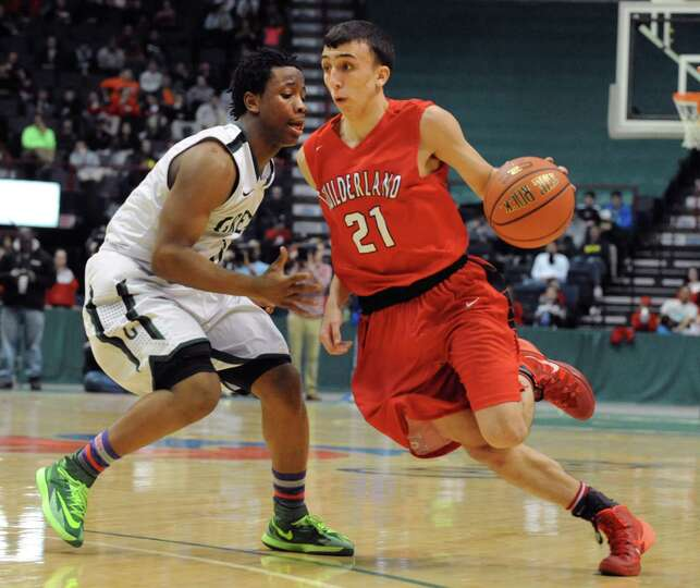 Guilderland's Vin Simeone, right, is guarded by Green Tech's Isiah Dobhere during the Class AA boys'