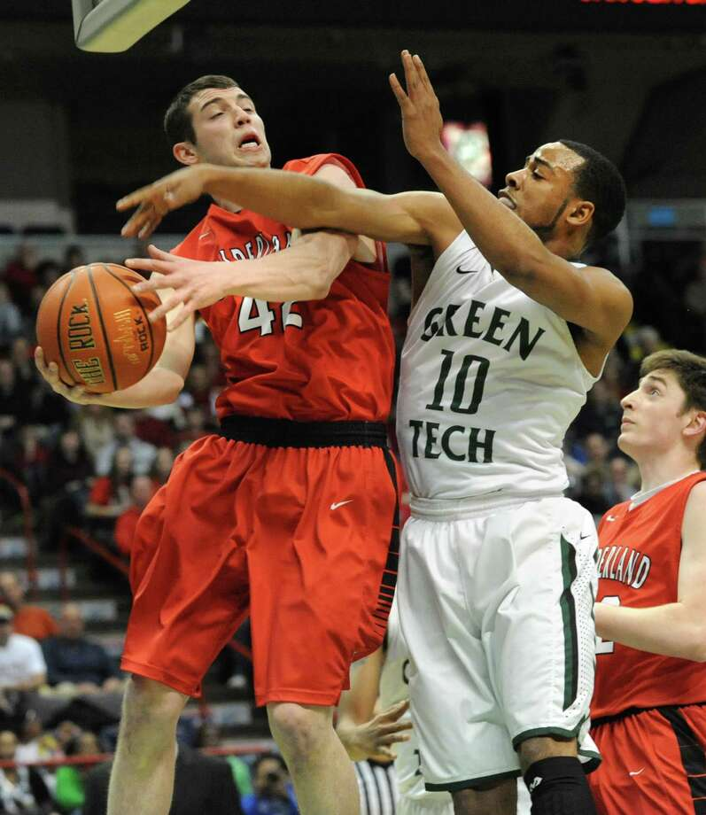 Guilderland's Marc DuMoulin, left, and Green Tech's Jizziah Carr battle for a rebound during the Class AA boys' basketball final at the Times Union Center on Monday, March 3, 2014 in Albany, N.Y. (Lori Van Buren / Times Union) Photo: Lori Van Buren / 00025965A