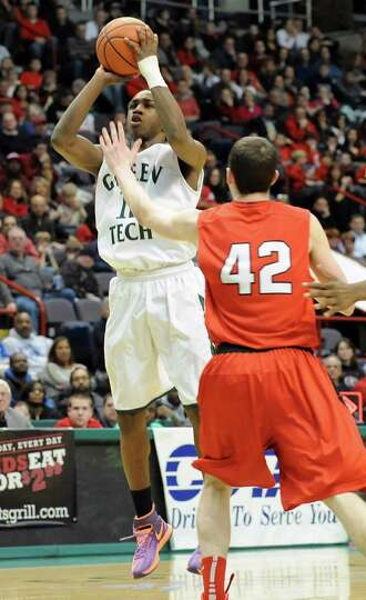 Green Tech's game MVP Jamil Hood Jr. makes a basket during the Class AA boys' basketball final again