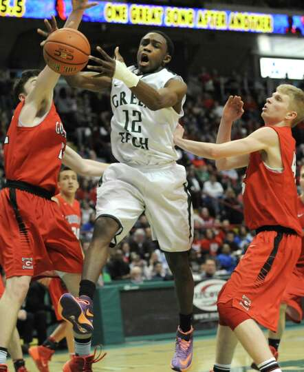 Green Tech's game MVP Jamil Hood Jr. is fouled as he drives to the basket during the Class AA boys'