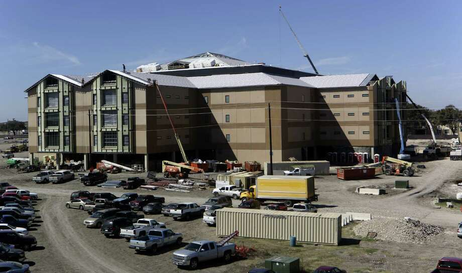 New dormitories are under construction at Joint Base San Antonio-Lackland. The military has an estimated $150 billion annual impact on Texas' economy. Photo: Photos By Helen L. Montoya / San Antonio Express-News / SAN ANTONIO EXPRESS-NEWS