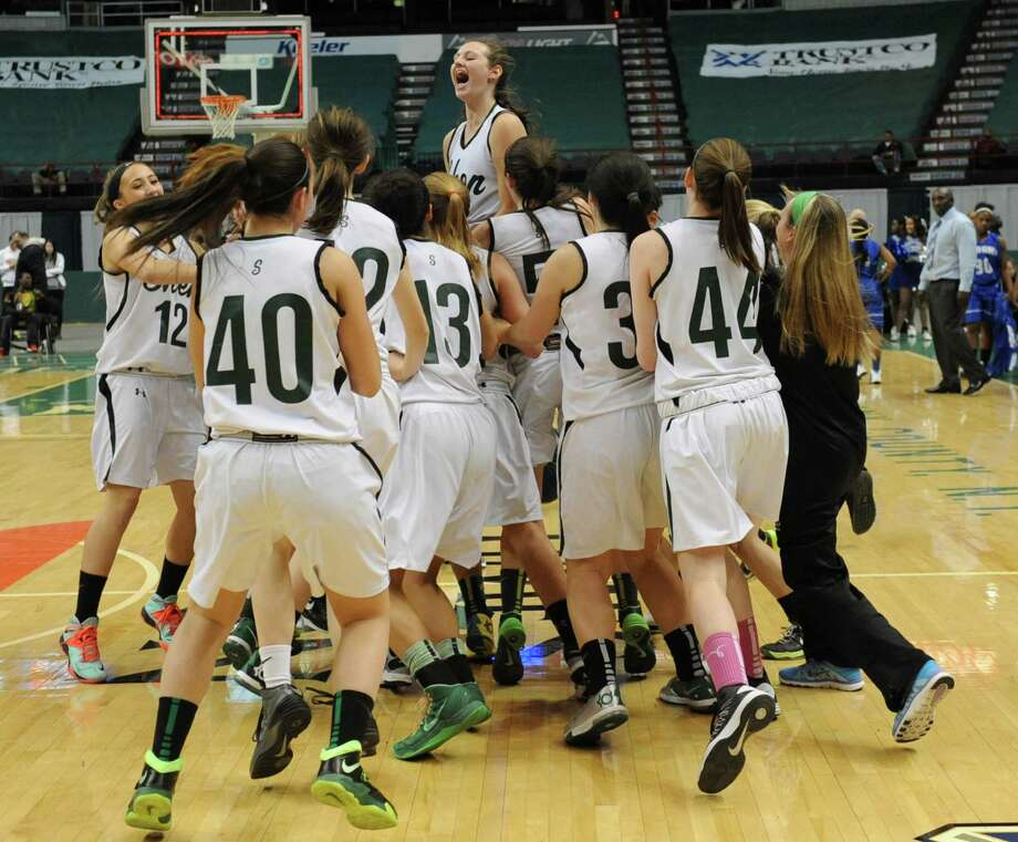 Shenendehowa girls celebrate after beating Albany in the Class AA girls' basketball title game at the Times Union Center on Monday, March 3, 2014 in Albany, N.Y. (Lori Van Buren / Times Union) Photo: Lori Van Buren / 00025964A