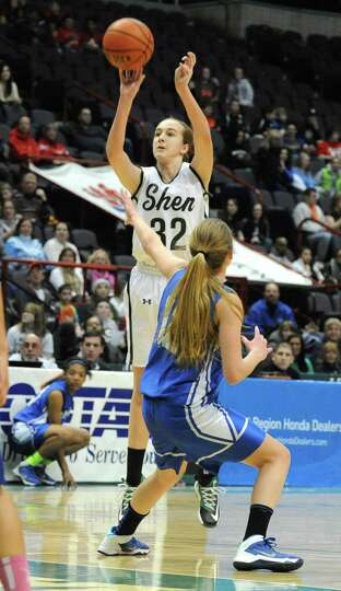 Shenendehowa's Carly Boland makes one of many of her three pointers during the Class AA girls' baske