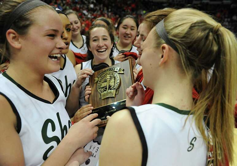 Shenendehowa girls celebrate after beating Albany in the Class AA girls' basketball title game at th