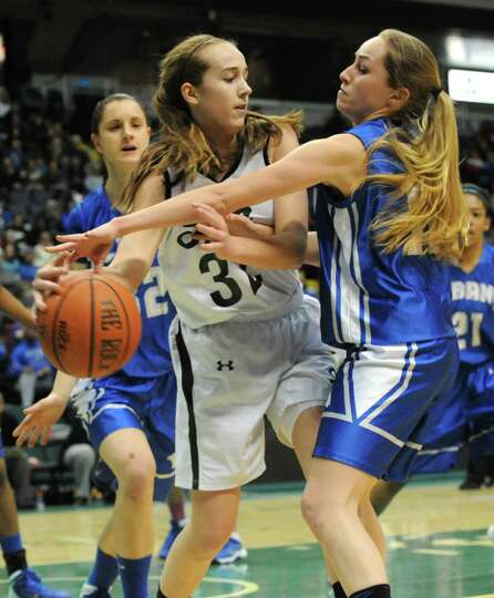 Shenendehowa's Carly Boland is guarded by Albany's Cara Waterson during the Class AA girls' basketba