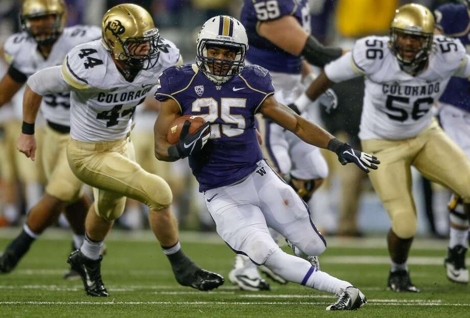 Who replaces Bishop Sankey as the Huskies' workhorse?To be clear: it's unlikely anybody replaces Sankey pound-for-pound. After all, all he did in 2013 was set a school record for rushing yards with 1,870 and score 20 touchdowns while shouldering the load for the Dawgs offense. Sankey will be playing on Sundays this fall, but the battle to take his spot will be one of the storylines to watch all spring long. Photo: Otto Greule Jr, Getty Images